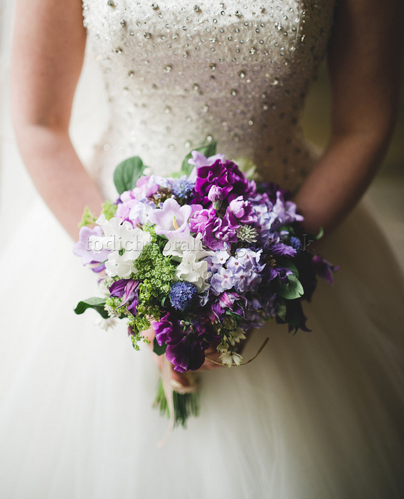 purple-wedding-flowers-london-sweet-peas-wedding-bouquet--white-bridal-dress-london-uk-wedding-florist-bridal-bouquets-affordable-prices