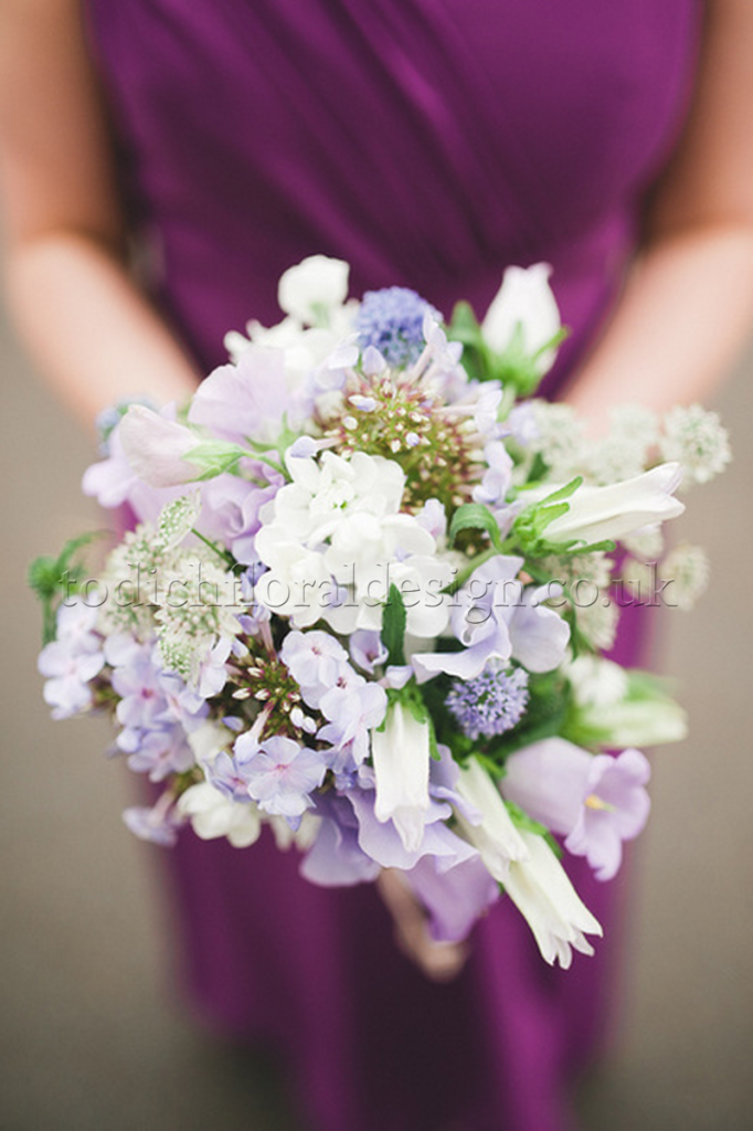 purple-wedding-flowers-london-sweet-peas-wedding-bouquet-white-bridal-dress-london-uk-wedding-florist-bridal-bouquets-affordable-prices